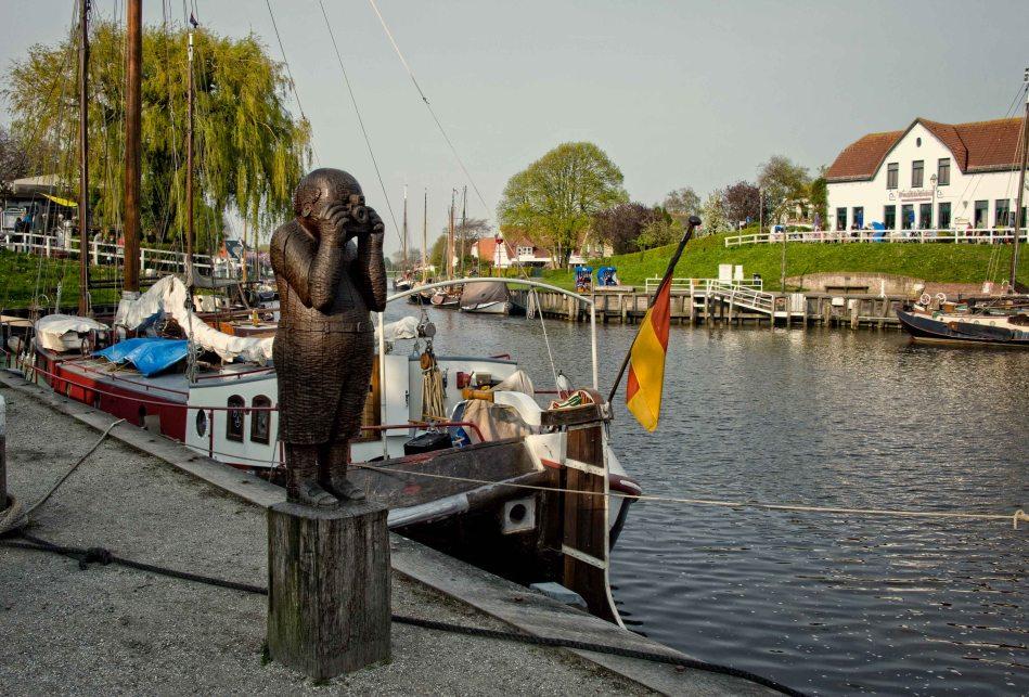 Photographer wooden sculpture